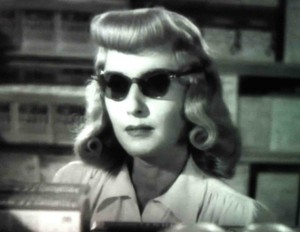 Wearing sharp sunglasses in Double Indemnity